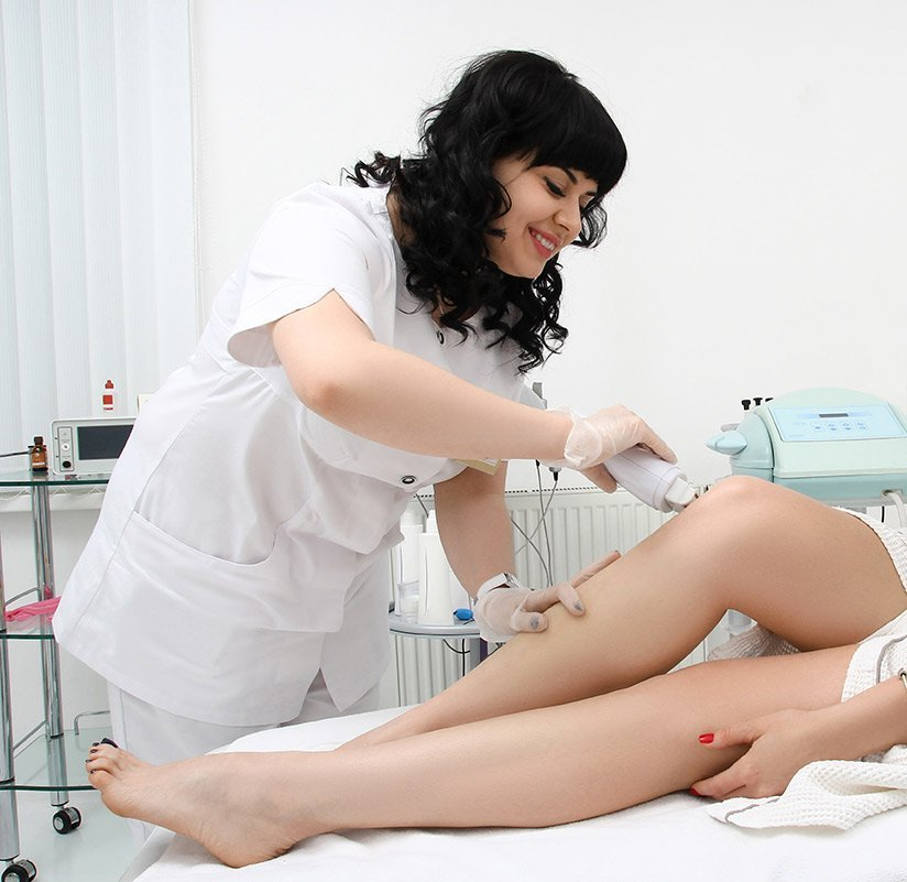 Photo of a beauty therapist performing a waxing treatment