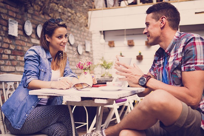couple sitting in a cafe happy after counselling for relationship problems